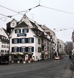A more trad view of Basel - it has heaps of old houses and s too 🚊 . .  travel switzerland winter christmas picturebook street tram gloomy