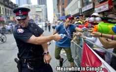 Mean while in Canada...looks like its more fun than anything. Let's settle all debates and war with water fights