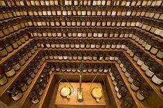 A rogue à parfum (perfume organ) with tiers of ingredient bottles arranged around a balance used to mix fragrances. Fragonard Musée du Parfum, Paris https://twitter.com/bigakukenkyujo/status/477803503985770498