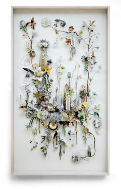 Flower constructions are 3d collages from pressed flowers and cut out flower pictures. Anne Ten Donkelaar meticulously places each element on pins which creates the depth. Some of them are like a fantasy Herbaria, filled with dried flowers or branches, with irregular shapes and sophisticated twists and some refer to planets.