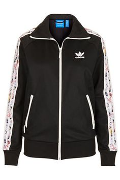 low priced 3efe9 753da Im embarrassed to say that I never have enough workout layers. I dig the  touch of print on the sleeves of this tracksuit top by Topshop x adidas  Originals.