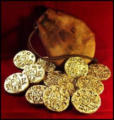 Esoteric Order of Dagon gold coins struck at the Marsh Refinery in Innsmouth. Miskatonic University Special Collections.