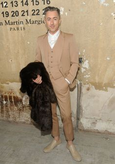 Alan Cumming. Not happy about the fur, but in love with the shoes...