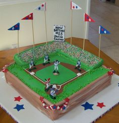 "dont like the sides on this one,,or the scoreboard, but is a good one for reference i think, since looks like ""actual game being played"". Fans and flags (but different colors, etc) Will call this Cake#2 if i reference it an a separate email"