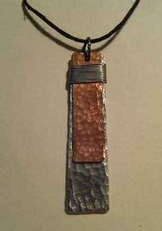 Hand pounded, hand cut metal jewelry...find it at https://www.etsy.com/shop/MoHiCreations
