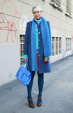 Shop this look on Lookastic:  http://lookastic.com/women/looks/pumps-tights-satchel-bag-sheath-dress-scarf-v-neck-sweater-coat/8959  — Dark Brown Leather Pumps  — Blue Tights  — Blue Leather Satchel Bag  — Orange Sheath Dress  — Blue Knit Scarf  — Mint V-neck Sweater  — Blue Coat
