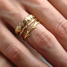 Set of 14K gold band rings in various designs