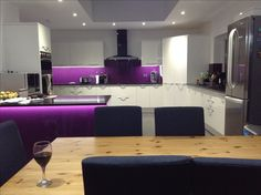 My actual kitchen in my actual house. This is where I live! Purple kitchen, purple splash back, breakfast bar Purple Kitchen, New Kitchen, Kitchen Diner Extension, Living Spaces, Rooms, Interiors, Bar, Live, Breakfast