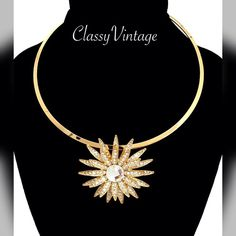 Stunning rhinestone floral choker Gold tone metal with a stunning double layer flower that is covered in rhinestones and one large stone in center. Chocolate Jewelry Necklaces