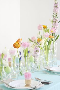 """Empty the glassware cabinet and fill each vessel with something that screams """"spring!"""" Fresh-cut flowers, dyed eggs, candles… The possibilities are endless, and the color potential is gorgeous."""