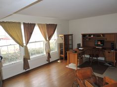 Great views and lots of natural light from triple windows in Living Room