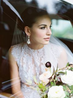 traditional bridal look, photo captured through the car window.