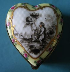 A 19th Century Vienna Porcelain Patch/Pill Box of a heart shape,gilt metal-mounted. Beehive Mark