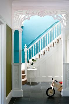 Gingerbread interior archway, architectural elements, and blue walls. Someone else had the same idea as me! So glad to have a pic for reference. White Stairs, White Banister, Turquoise Walls, Blue Walls, White Walls, Architectural Elements, My Living Room, Stairways, My Dream Home