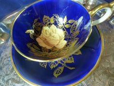 Aynsley tea cup and saucer athens cobalt blue white rose outlined in gold c1930