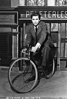 Glenn Ford riding a bike on the set of The Lady in Question, 1940.