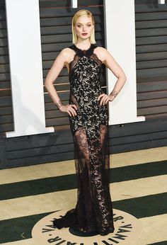 Bella Heathcote at the 2015 Vanity Fair Oscar After-Party wearing a black lace halter neck gown with sheer floral lace detail