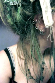 upswept green, pierced + strappy black