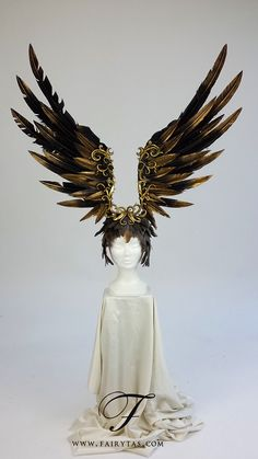 Rise from the ashes with this magnificent black and gold headpiece with handcrafted filigree detailing! Made with wearability in mind the wings are set