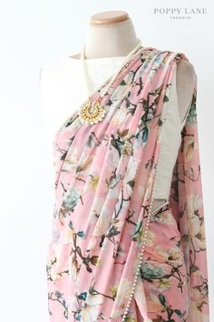 This floral saree is perfect for any occasion. Silky georgette with a white beaded trim. Shop now at poppylane.ca