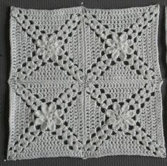 """Pretty Petals - 12"""" square by Melinda Miller, free pattern on Ravelry"""