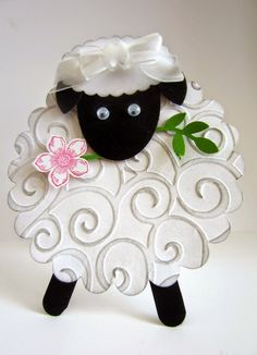 This sweet little lamb is made from a scalloped circle and swirly embossing plate.  She even has a snack of a Petite Petals flower.  Handmade Easter card.