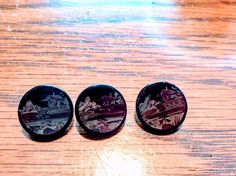 Old hand painted glass buttons . I think that the are from Japan.