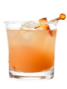 Gingered Peach Margarita    Coarse sea or kosher salt  1 lime wedge  1 small, very ripe peach, pitted and diced, plus a peach slice for garnish  ½ tsp peeled, grated ginger root  ¾ oz (1½ Tbsp) fresh lime juice  ¼ oz (1½ tsp) light agave nectar  2 oz (¼ cup) 100% blue agave silver tequila  ½ oz (1 Tbsp) Cointreau or triple sec