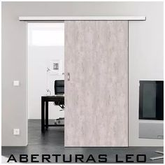 puerta corrediza guia externa colgante simil madera concreto