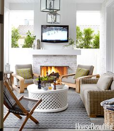 Love the lantern, coffee table, white-washed brick and fireplace.