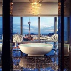 A bathroom with views like this . You'd soak in that bath for hours . Luxurious opulent and glamorous.  #follow4follow #glamour #bondi #sydney #woollahra #luxurious #opulent #glamourous #soak #tiles #tile #interiordesign #interior #interiors #architecture #archilovers #architecturelovers #architect #architexture #archidaily #instagood #instadaily #instalike #instagram #cerastonetiles #marble #italian #luxury #luxurylifestyle #luxurylife Dream Bathrooms, Beautiful Bathrooms, Luxurious Bathrooms, Master Bathrooms, Pent House, Macau, Luxury Hotel Bathroom, Bathroom Interior, Cozy Bathroom