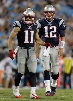 Julian Edelman Photos Photos - Tom Brady #12 of the New England Patriots and  Julian Edelman #11 during their game at Bank of America Stadium on August 26, 2016 in Charlotte, North Carolina. - New England Patriots v Carolina Panthers