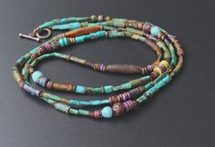 Long necklace by Elena Doronina. Turquoise, copper beads, ceramic beads, glass beads from Ghana, beautiful agate tubes and couple Roman glass beads from Pakistan.