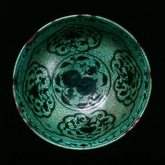 Fritware bowl, painted in black under a transparent, turquoise glaze  Iran, Nishapur?; 2nd half of 15th century  H: 13; Diam: 26 cm