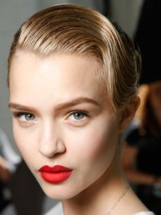 Clean face and matte red lips.