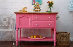 Kitchen island painted pink. www.thewoodspa.com