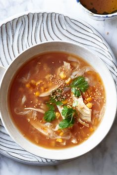 This chicken soup recipe incorporates corn, ginger, soy sauce, eggs, cilantro and lemon to create the ultimate light and comforting fall recipe. Whether you're looking to eat this soup for a fall dinner alongside some crusty bread or heat up the leftovers for a quick and easy lunch the next day, it's a great choice for a comfort food recipe.#souprecipes #stewrecipes #comfortfood #fallrecipes #falldinners