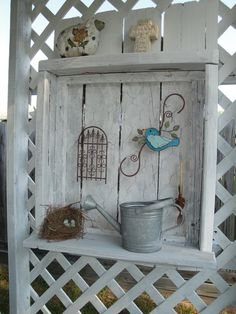 cute idea for rustic shelf on trellis with chicken wire for hanging decorations
