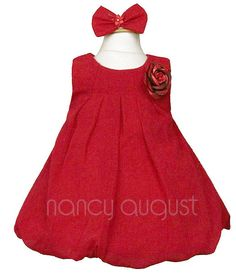 Red Chiffon Infant Dress with Balloon Skirt: This red chiffon infant dress speaks for itself. It's all about putting your infant in a fun and sassy dress. You're smile will stretch from left to right when you see your little infant girl and her sister put on matching dresses for Christmas holiday pictures this season. This lightly textured chiffon dress is made with care and is soft to the touch so that the youngest of infant girls can be comfortable while looking her best.