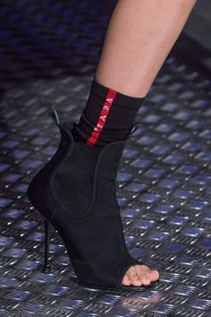 Prada shoes fall 2018 on the runway are perfect hybrid of sportswear and  classic basics. Chelsea boots were given a sporty makeover. 41b8950234
