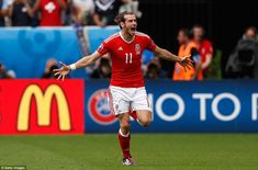 Real Madrid superstar Gareth Bale races away in celebration after scoring the opening goal of Wales' Group B clash with Slovakia