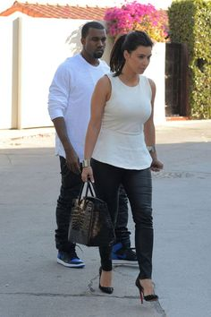 Kanye West was seen leaving his Los Angeles house with girlfriend Kim Kardashian.