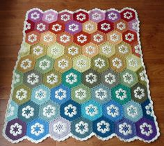 Rooknits' African Flower Afghan; free pattern on Ravelry. Love this version with the white in each.