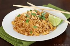 Easy Pad Thai  8 ounces wide rice noodles  2 tbs. brown sugar  3 tbs. fresh lime juice  4 tbs. low-sodium soy sauce  1 tsp. Sriracha (or to taste)  2 tsp. vegetable oil  2 garlic cloves, minced  1/2 cup sliced green onion  2 eggs  1/4 cup chopped peanuts  cilantro (for garnish)  additional lime wedges (for garnish)