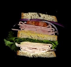 Turkey, Ham, Lettuce, Tomato, Onion, Swiss, Mayo, Mustard, on Wheat Bread