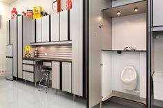 Should You Install a Urinal at Home? Wall-mounted pit stops are handy in more than just man caves — and they can look better than you might think. modern garage and shed by Closet Organizing Systems