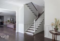 Hamptons style Entry and Staircase, with dark timber flooring and dado wall feature. Custom design by Orbit Homes. Transitional Living Rooms, Transitional Kitchen, Transitional Decor, Living Room Furniture Layout, Benjamin Moore, House Design, House Styles, Hampton Style, Stairs