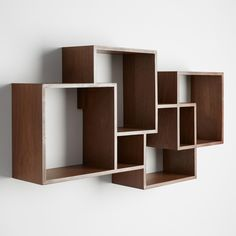 Featuring four cubbies and two smaller niches, this artistic wall-mounted wood shelf with rich walnut finish exudes midcentury modern charm and provides a stylish spot for books, trinkets, vases or picture frames.
