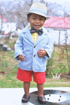 Follow @beckettoakes on Instagram for more kid fashion and #ootd inspiration. Fedora by Old Navy. Mustard checkered button up and seer sucker blazer by Gap Kids. Coral chino shorts and brown penny loafers by Janie and Jack. Floral Bow tie by Serene Handmade.
