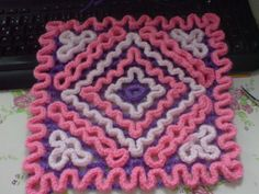 This dishcloth is made in the Wiggly Crochet Technique, with the foundation mesh being made first. Then wiggly crochet stitches are added to the mesh, forming the diagonals design. The pattern includes written instructions and a wiggly crochet chart. Wiggly Crochet Patterns, Crochet Flower Patterns, Basic Crochet Stitches, Crochet Chart, Crochet Squares, Crochet Motif, Crochet Designs, Crochet Afghans, Crochet Hot Pads
